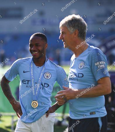 Raheem Sterling of Manchester City alongside coach Brian Kidd