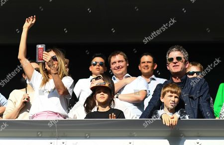 Noel Gallagher looks on with his wife Sara Macdonald and his sons Donovan and Sonny, right