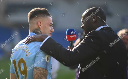 Yaya Toure working for Sky Sports talks to Ederson of Manchester City