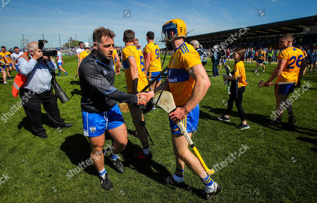 Stock Image of Waterford vs Clare. Waterford's Noel Connors with Patrick O'Connor of Clare after the game