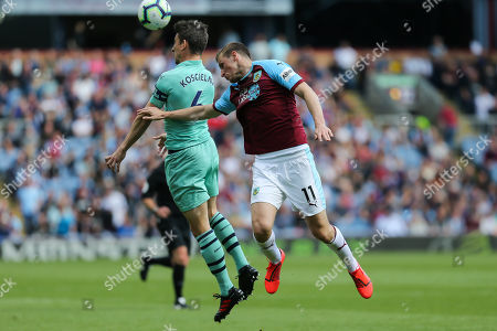 Arsenal defender Laurent Koscielny (6) heads the ball in front of Burnley forward Chris Wood (11) during the Premier League match between Burnley and Arsenal at Turf Moor, Burnley