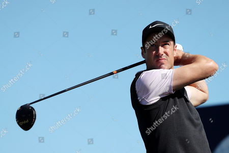 Ross Fisher of England tees off the 5th during Day Four of the Betfred British Masters at Hillside Golf Club