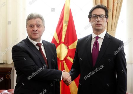 Stock Picture of Stevo Pendarovski, right, the new elected President of North Macedonia shakes hands posing for the media with the former President Gjorge Ivanov, left, during a ceremony to hand over duties, upon his arrival at the presidential palace in Skopje, North Macedonia, . Pendarovski has been sworn in as the new president of North Macedonia, promising he will serve all citizens in a deeply divided society and will lobby European Union leaders to approve the start of his country's accession talks in June