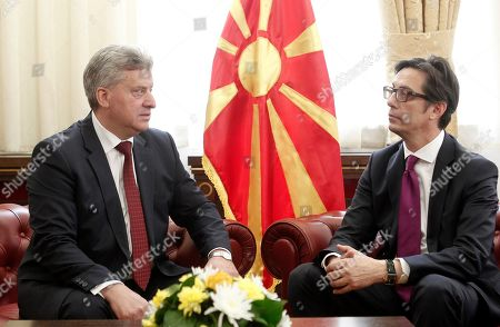 Stevo Pendarovski, right, the new elected President of North Macedonia talks with the former President Gjorge Ivanov, left, during a ceremony to handover the duties, at the presidential palace in Skopje, North Macedonia, . Pendarovski has been sworn in as the new president of North Macedonia, promising he will serve all citizens in a deeply divided society and will lobby European Union leaders to approve the start of his country's accession talks in June