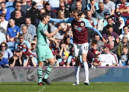 Laurent Koscielny of Arsenal and Peter Crouch of Burnley