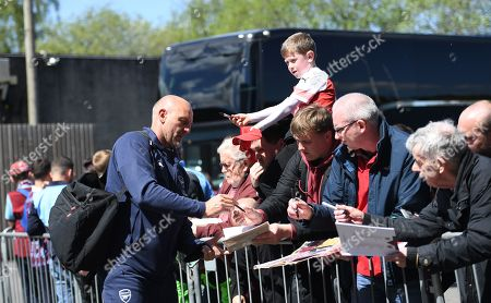 Steve Bould Assistant Head Coach of Arsenal signs autographs for fans