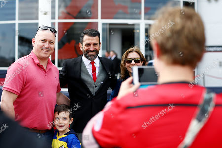 Stock Photo of Former footballer Francis Benali poses for photos after he reached his £1m fundraising goal by completing five Ironman triathlons inside a week.