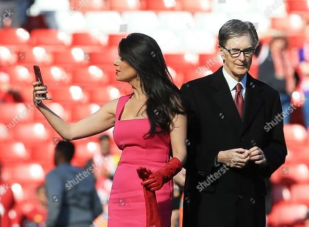 Liverpool owner John W Henry with his wife Linda Pizzuti at the end of the game
