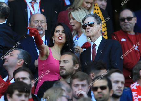 Liverpool owner John W Henry with his wife Linda Pizzuti