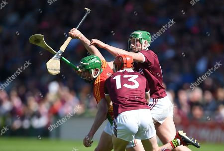 Galway vs Carlow. Carlow's David English with Conor Whelan and Niall Burke of Galway