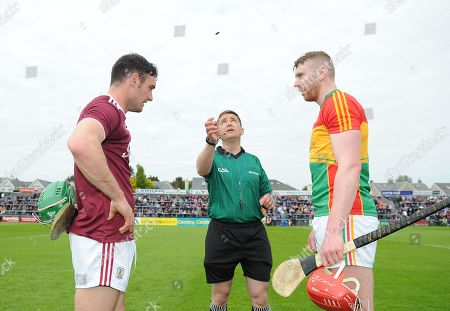 Galway vs Carlow. Referee Colm Lyons with team captains Galway's David Burke and Edward Byrne of Carlow during the coin toss