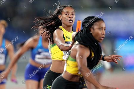 Stephenie Ann McPherson (C) of Jamaica competes in the Women's 4x200m Relay Final at the IAAF World Relays 2019 in Yokohama, south of Tokyo, Japan, 12 May 2019.
