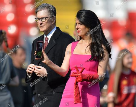 Liverpool owner John W. Henry (L) and his Linda Pizzuti Henry on the pitch after the English Premier League match between Liverpool FC and Wolverhampton Wanderers FC at Anfield, Liverpool, Britain, 12 May 2019.