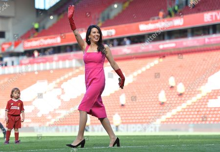 Linda Pizzuti Henry, wife of Liverpool owner John W. Henry, walks on the pitch after the English Premier League match between Liverpool FC and Wolverhampton Wanderers FC at Anfield, Liverpool, Britain, 12 May 2019.