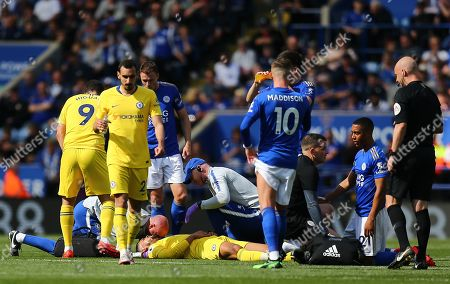 Ruben Loftus-Cheek of Chelsea receives treatments after heads clash with  Youri Tielemans of Leicester