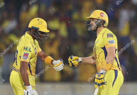 Shane Watson, D J Bravo. Chennai Super King's Shane Watson, right, and D J Bravo meet between the wickets during the VIVO IPL T20 cricket final match between Mumbai Indians and Chennai Super Kings in Hyderabad, India