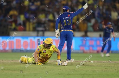 Stock Picture of Chennai Super King's Shane Watson, left, falls on the ground after being run-out during the VIVO IPL T20 cricket final match between Mumbai Indians and Chennai Super Kings in Hyderabad, India