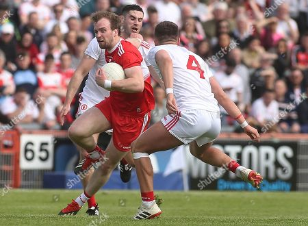 Tyrone vs Derry. Derry's Padraig Cassidy with Michael Cassidy and Michael McKernan of Tyrone