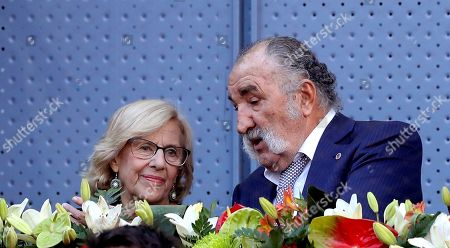 Madrid's Mayoress Manuela Carmena and Romanian former tennis player Ion Tiriac (R) at the Mutua Madrid Open tennis tournament in Madrid, Spain, 12 May 2019.