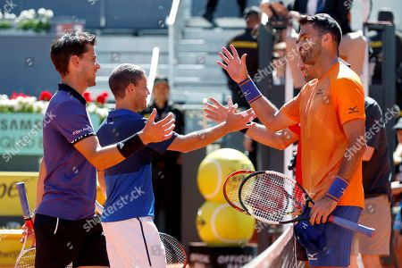 Horia Tecau of Romania (R) and Jean-Julien Rojer of Netherlands (R) greet Diego Schwartzman of Argentina (2-L) and Dominic Thiem of Austria (L) after winning their men's doubles final at the Mutua Madrid Open tennis tournament in Madrid, Spain, 12 May 2019.
