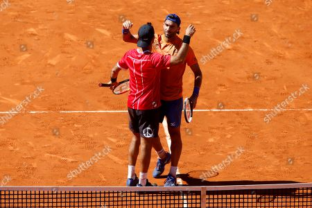 Horia Tecau of Romania (R) and Jean-Julien Rojer of Netherlands (L) celebrate their win over Diego Schwartzman of Argentina and Dominic Thiem of Austria in the men's doubles final at the Mutua Madrid Open tennis tournament in Madrid, Spain, 12 May 2019.
