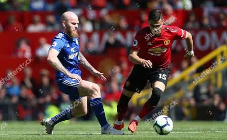 Andreas Pereira of Manchester United is challenged by Aron Gunnarsson of Cardiff City.