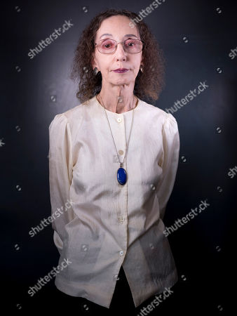 American author Joyce Carol Oates poses for a photo in Jerusalem, . Oates says her family's denial of its Jewish roots haunted her for decades and has shaped her into the famously prolific writer she is today. Oates, who is making her first-ever trip to Israel to receive the prestigious Jerusalem Prize, said that her Jewish grandmother fled persecution in her native Germany to rural upstate New York in the late 19th century
