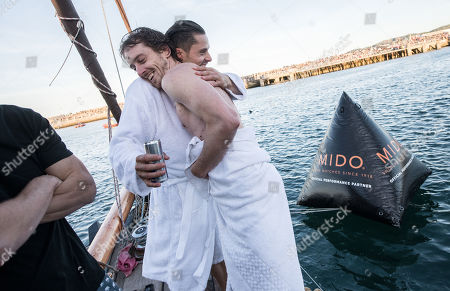 Gary Hunt (R) of the UK and Constantin Popovici of Romania celebrate at Dun Laoghaire Harbour after the second stop of the Red Bull Cliff Diving World Series