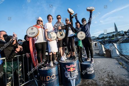 Lysanne Richard of Canada, Gary Hunt of the UK, Constantin Popovici of Romania, Rhiannan Iffland of Australia, Adriana Jimenez of Mexico and David Colturi of the USA celebrate on the podium at Dun Laoghaire Harbour after the second stop of the Red Bull Cliff Diving World Series