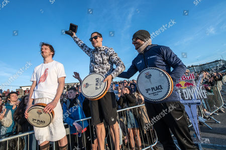 Gary Hunt of the UK, Constantin Popovici of Romania and David Colturi of the USA celebrate on the podium at Dun Laoghaire Harbour after the second stop of the Red Bull Cliff Diving World Series in Dublin