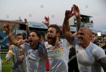 Newport County's Robbie Willmott, David Pipe and Mark O'Brien celebrate