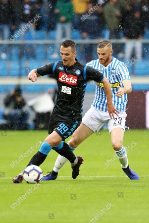 Spal's Francesco Vicari (R) and Napoli's Arkadiusz Milik (L) in action during the Italian Serie A soccer match between Spal 2013 and SSC Napoli at Paolo Mazza Stadium in Ferrara, Italy,12 May 2019.