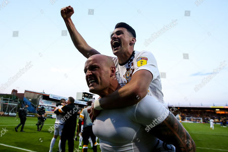 David Pipe and Regan Poole of Newport County celebrate after winning through to the Sky Bet League Two Playoff Final