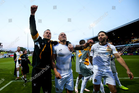 Newport County manager Michael Flynn, David Pipe and Robbie Willmott of Newport County celebrate after winning through to the Sky Bet League Two Playoff Final