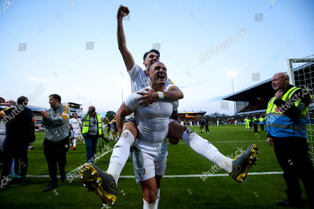 Regan Poole and David Pipe of Newport County celebrate winning through to the Sky Bet League Two Playoff Final