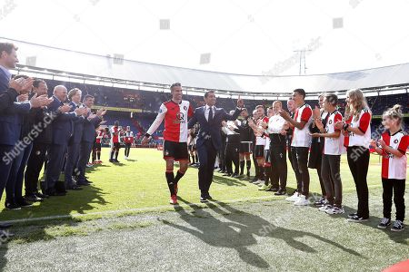 Feyenoord's Robin van Persie (C-L) and Feyenoord's head coach Giovanni van Bronckhorst (C-R) wave to the fans during their farewell ceremony after the Dutch Eredivisie soccer match between Feyenoord and Den Haag in Rotterdam, The Netherlands, 12 May 2019.