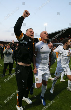 Newport County manager Michael Flynn celebrates with David Pipe of Newport County after winning the penalty shoot out and heading to Wembley for the League 2 Play Off Final