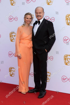 Kelsey Grammer, Kayte Walsh. Actor Kelsey Grammer, and partner actress Kayte Walsh pose for photographers on arrival at the 2019 BAFTA Television Awards in London
