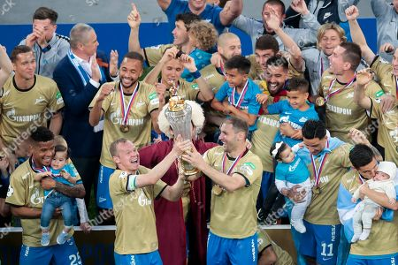 Stock Photo of Zenit's Alexander Anyukov, center left, and Branislav Ivanovic, center right, and other teammates celebrate their victory after the Russian premier league soccer match between CSKA Moscow and Zenit in St. Petersburg, Russia, . Zenit won their match against CSKA Moscow to win the Russian premier league soccer title