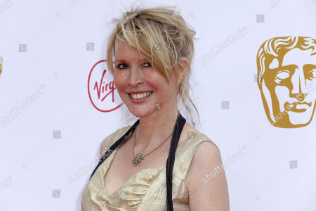Julia Davis poses for photographers on arrival at the 2019 BAFTA Television Awards in London