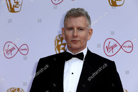 Patrick Kielty poses for photographers on arrival at the 2019 BAFTA Television Awards in London