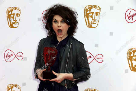 Caitlin Moran poses for photographers on arrival at the 2019 BAFTA Television Awards in London