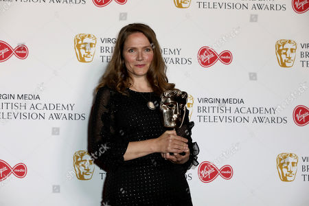 Jessica Hynes poses with her award for 'best female comedy performance' at the 2019 BAFTA Television Awards in London