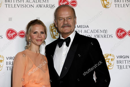 Kayte Walsh, Kelsey Grammer. Actor Kelsey Grammer, and partner, actress Kayte Walsh pose for photographers after appearing at the 2019 BAFTA Television Awards in London