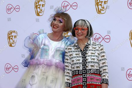 Grayson Perry, Philippa Perry. Artist Grayson Perry, and partner Philippa Perry pose for photographers on arrival at the 2019 BAFTA Television Awards in London