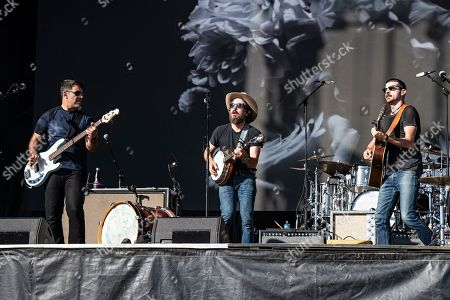 Scott Avett; Seth Avett; Bob Crawford. Bob Crawford, from left, Scott Avett, and Seth Avett of The Avett Brothers perform on stage at KAABOO Texas at AT&T Stadium, in Arlington, Texas