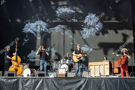 Scott Avett; Seth Avett; Bob Crawford; Joe Kwon. Bob Crawford, front row L-R, Scott Avett, Seth Avett, and Joe Kwon of The Avett Brothers perform on stage at KAABOO Texas at AT&T Stadium, in Arlington, Texas