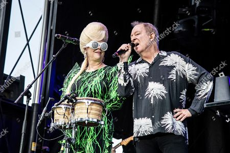 Cindy Wilson; Fred Schneider. Cindy Wilson, left, and Fred Schneider of the B52s perform on stage at KAABOO Texas at AT&T Stadium, in Arlington, Texas