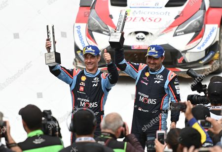 Stock Photo of French Sebastien Loeb (L) and Daniel Elena of Hyundai team celebrate their third place at podium of the Rally Chile 2019, in Concepcion, Chile, 12 May 2019.