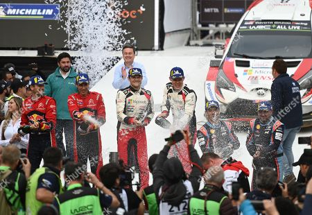 Stock Image of Estonian Ott Tanak (C-R) of Toyota, first place; French Sebastien Ogier (L) of Citroen, second place, and Sebastien Loeb (2-R) of Hyundai, third place, pose in the podium of the Rally Chile 2019, in Concepcion, Chile, 12 May 2019.